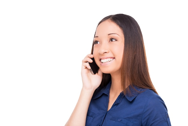 Good talk. beautiful young asian woman talking on the mobile phone and smiling