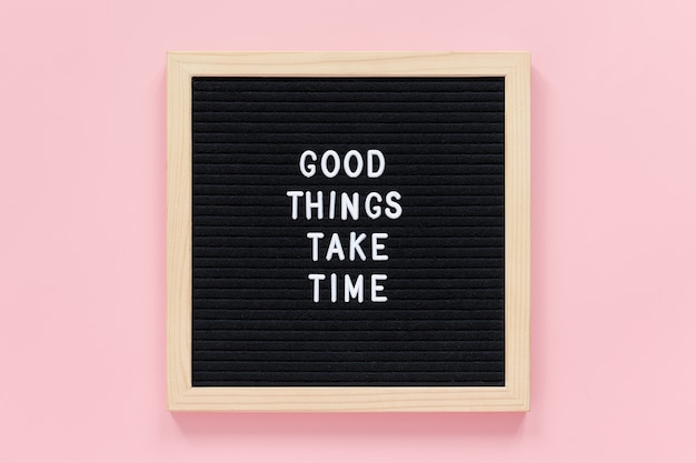 Good things take time. motivational quote on black letter board concept inspirational quote of the day.