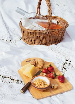 Goodies on chopping board next to straw basket