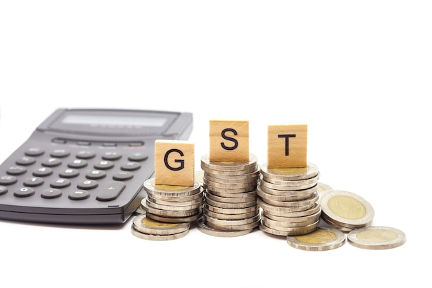 Goods and services tax word on stack coins isolate.