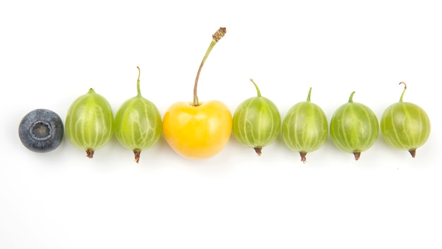 Gooseberries and other berries on a white surface. useful vitamin healthy food fruit. healthy vegetable breakfast
