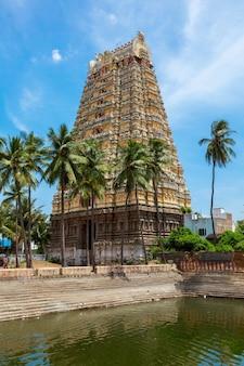 Gopura (tower) and temple tank of lord bhakthavatsaleswarar temp