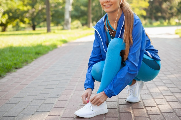 Gorgeous athletic woman working out in the park in the morning