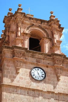 Gorgeous bell tower with a clock of the puno cathedral, puno, peru