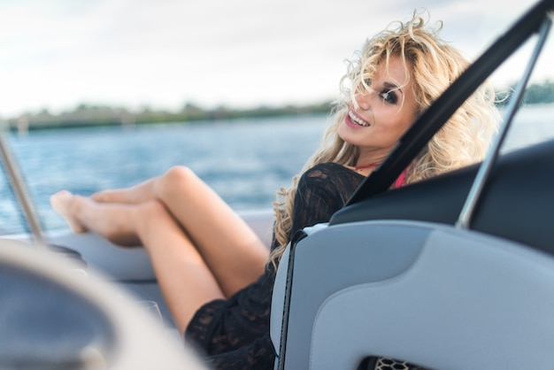 Gorgeous blond girl resting on a yacht