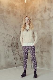 Gorgeous blond woman in beige sweater