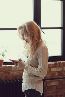 Gorgeous blond woman texting