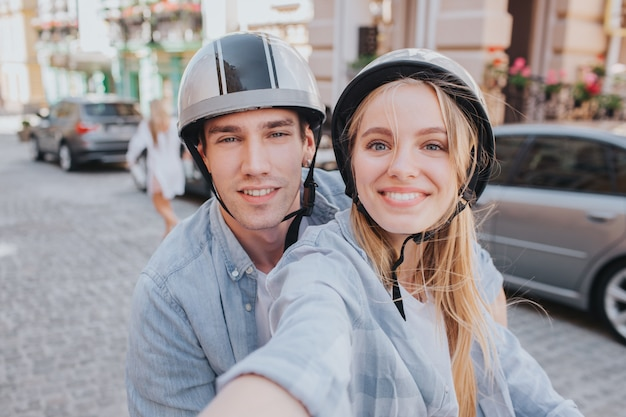 Gorgeous couple riding a motorcycling in the city