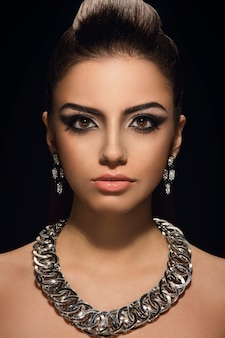 Gorgeous, cute woman with beautiful necklace