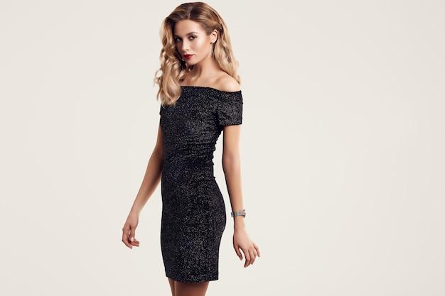 Gorgeous elegant sensual blonde woman wearing fashion black dress