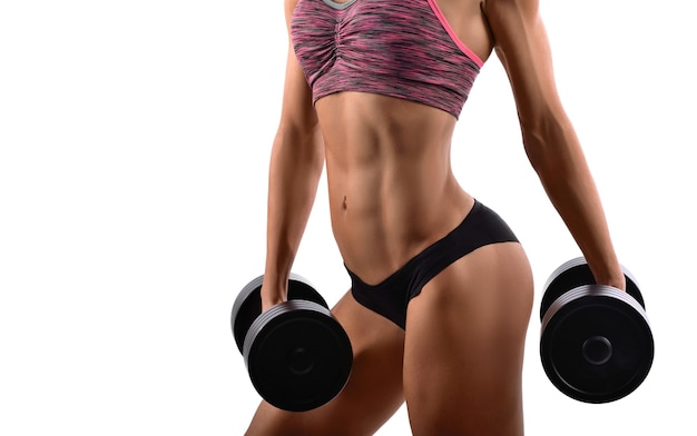 Gorgeous fitness woman with dumbbells