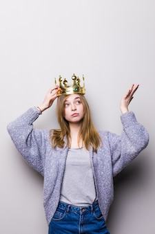Gorgeous girl holding crown on head