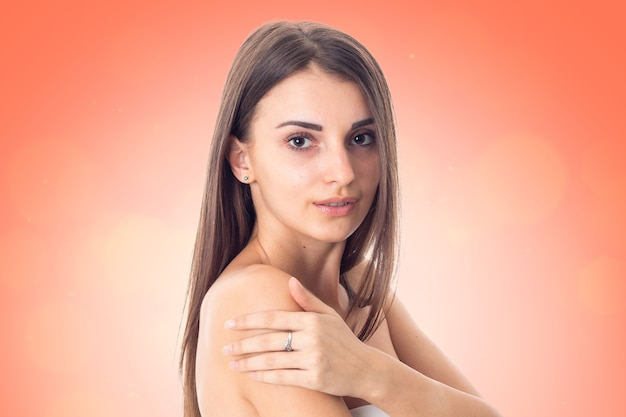 Gorgeous girl takes care her skin isolated on white background. health care concept. body care concept. young woman with healthy skin.