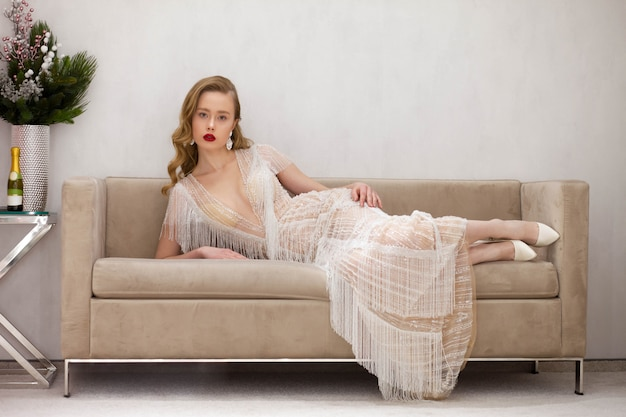 Gorgeous lady posing on a beautiful couch