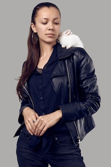 Gorgeous latin women in fashion leather jaket with cute little rabbit