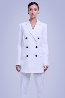 Gorgeous latin women in fashion white suit