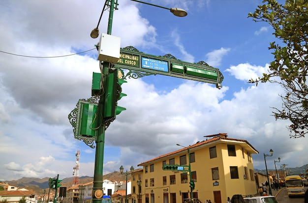 Gorgeous old style urban signpost and traffic signal on avenida el sol, the main avenue in cusco of peru