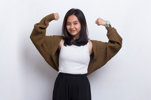 Gorgeous strong young asian woman  happy and excited celebrating victory expressing big success
