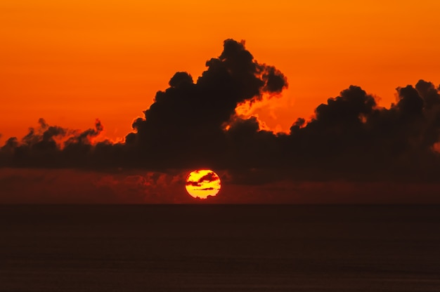 Gorgeous sunset on horizon and dark clouds above it iriomote island