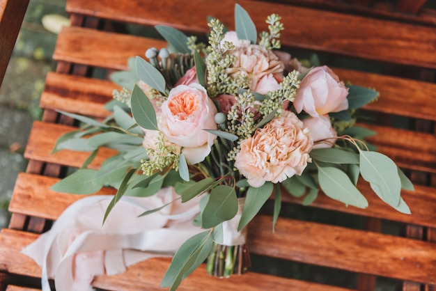 Gorgeous wedding bouquet containing eucalyptus and peonies