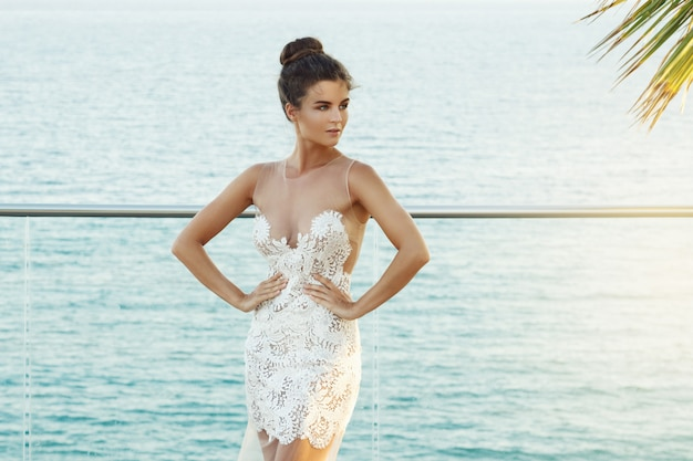 Gorgeous woman in beautiful white dress