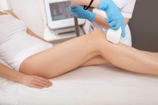Gorgeous woman getting laser hair removal