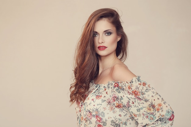 Gorgeous woman posing with floral dress, fashion concept