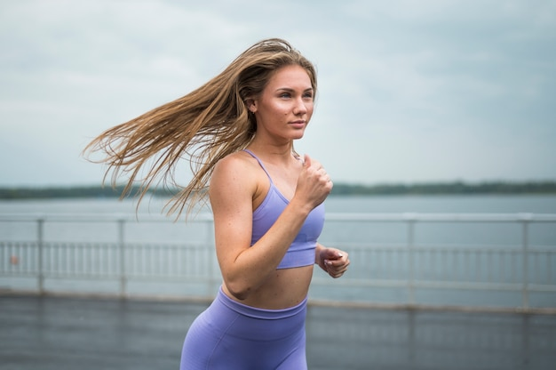 Gorgeous woman running medium shot