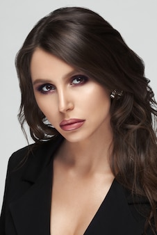 Gorgeous woman with perfect skin and makeup after beauty salon