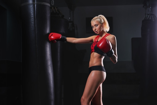 Gorgeous young strong and fit woman training boxing