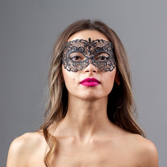Gorgeous young woman with mask