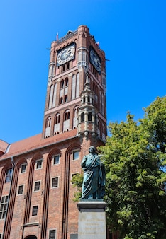 The gothic old town hall ratusz staromiejski holy spirit church and copernicus monument in torun