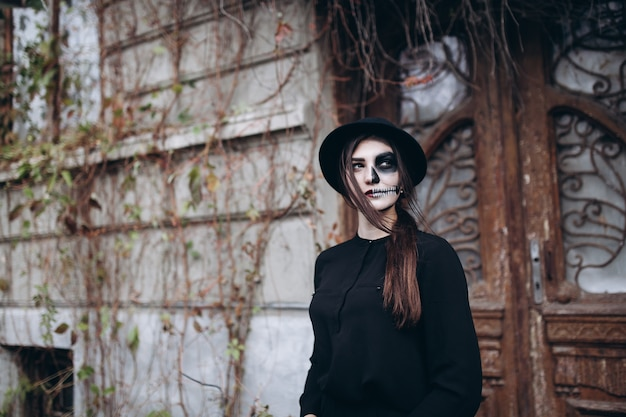 Gothic young woman in  halloween costume