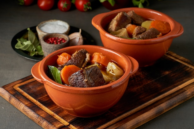 Goulash with large pieces of beef and vegetables. burgundy meat. slow stewing, cooking.