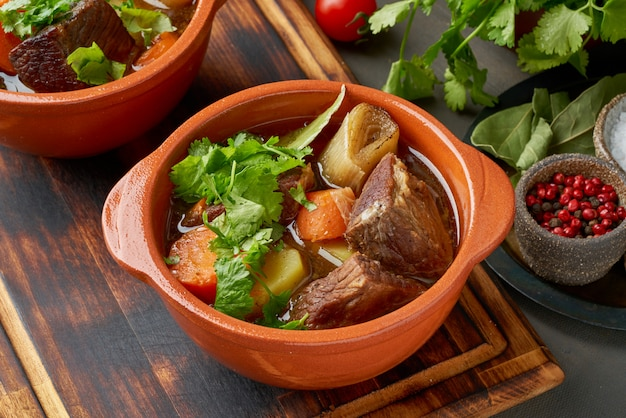 Goulash with large pieces of beef and vegetables.