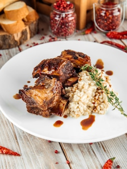 Gourmet beef stewed ribs with pearl barley risotto