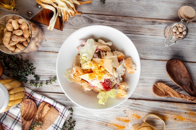 Gourmet caesar salad with chicken and iceberg lettuce