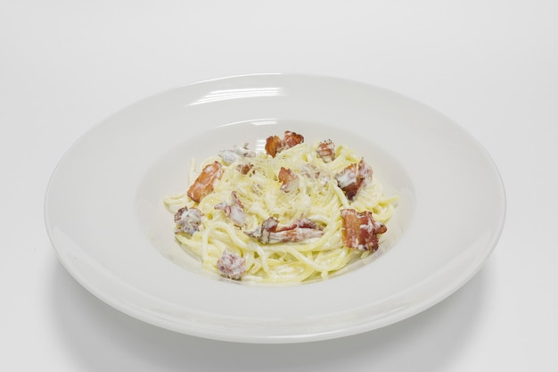Gourmet carbonara pasta on a white background. top view. mixed media