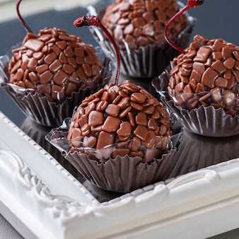 Gourmet cherry brigadeiro. typical brazilian sweet with condensed milk and chocolate. selective focus