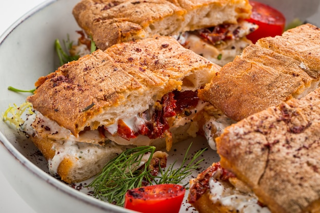 Gourmet festive sandwiches with sundried tomatoes
