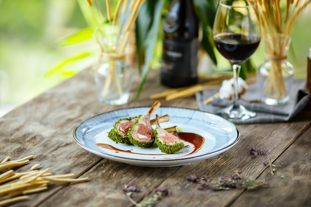 Gourmet herb-crusted lamb chopswith wilted spinach