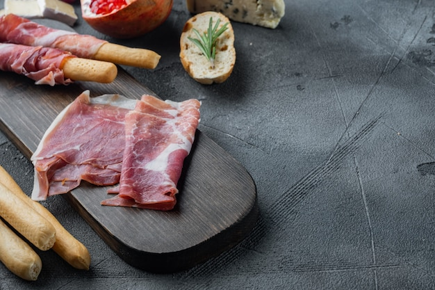 Gourmet, manually sliced jamon set, on gray table