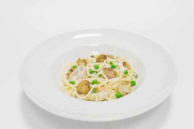 Gourmet pasta with chicken breast, green peas and baked mushrooms. top view. mixed media