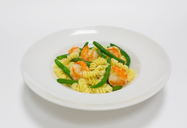 Gourmet pasta with tiger prawns and green beans. top view. white background. healthy eating concept. mixed media