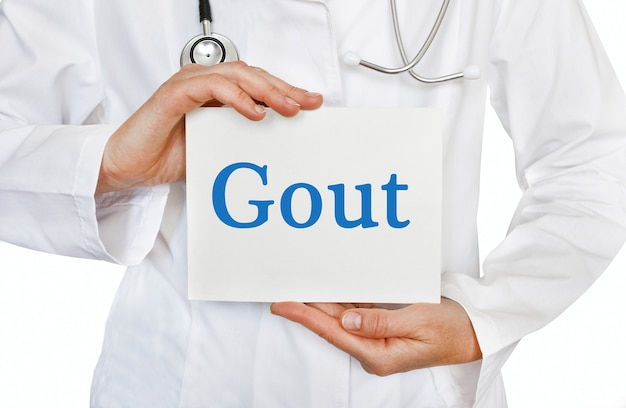 Gout card in hands of medical doctor