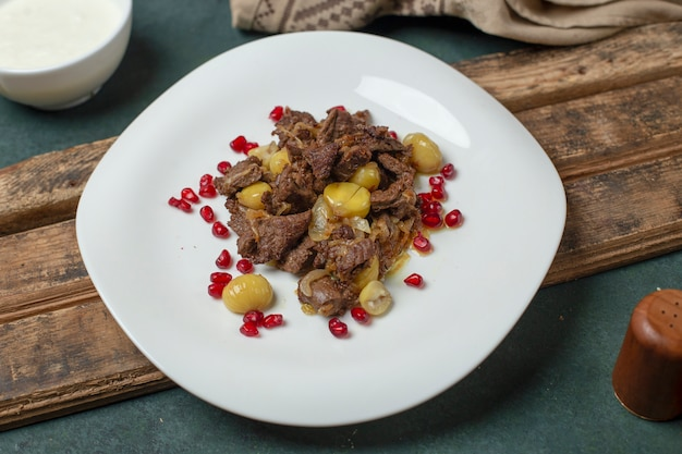 Govurma meat with chestnuts and seeds