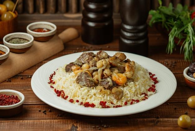 Govurma plov, national azerbaijani food with rice garnish and dry fruits