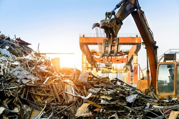 Grab crane works in waste recycling station