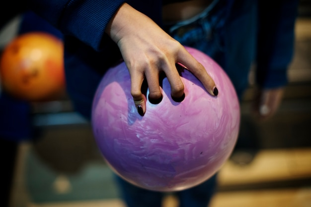 Grabbing the pink bowling ball