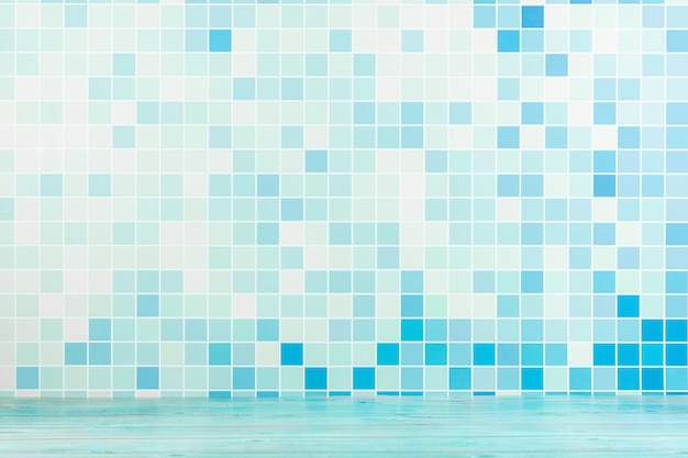 Gradient of abstract blue grid tile wall.
